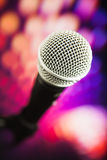 Microphone against purple background Stock Photo