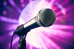 Microphone against purple background Stock Photos