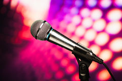 Microphone against purple background Stock Photography