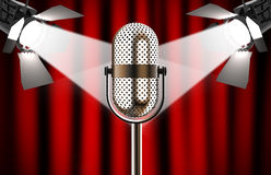 Microphone against red curtain with spotlights Royalty Free Stock Images