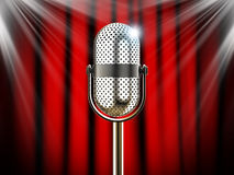 Microphone against red curtain with spotlights Stock Images
