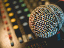 Microphone on amplifier equipment and out of focus background.: Royalty Free Stock Photo