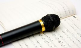 Microphone And Book Of Notes Royalty Free Stock Photography