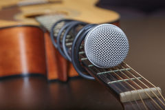 Microphone attached to the guitar neck. Royalty Free Stock Photography