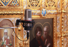 Microphone attached to wall inside Cathedral Stock Photos