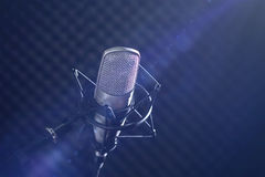 Microphone and audio console on dark background Royalty Free Stock Images