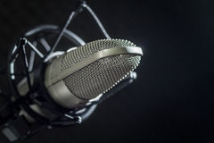Microphone and audio console on dark background Stock Image
