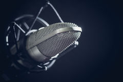 Microphone and audio console on dark background Royalty Free Stock Photo