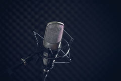 Microphone and audio console on dark background Royalty Free Stock Photography