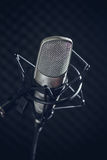 Microphone and audio console on dark background Stock Photos