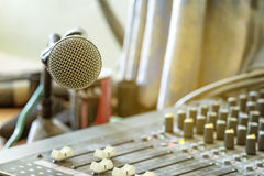 Microphone on the audio mixer in the conference room.  Stock Photos