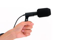 Microphone avec la main Photographie stock libre de droits