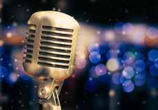 Microphone on a background of blue lights Stock Images