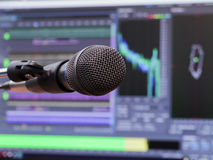 Microphone on the background of the computer monitor. Home recording Studio. Close-up. The focus in the foreground Stock Image