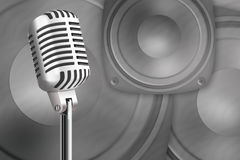 Microphone on a background loud speakers Royalty Free Stock Image