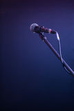 Microphone on a black background, the music concept, beautiful lighting on the stage. Closeup Stock Photo