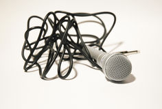 Microphone with black cord. Silver microphone with black cord on the white background Stock Image
