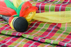 Microphone black loincloth background. Microphone is encased with a rag and place it on a piece of colorful cloth Stock Images