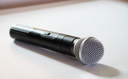 Microphone. Black microphone on white background with shadows on morning royalty free stock photos