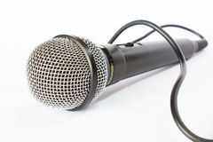 Microphone with black wire isolated on white Stock Photo