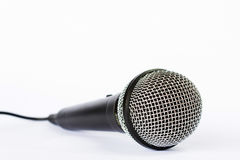 Microphone with black wire isolated on white Stock Images