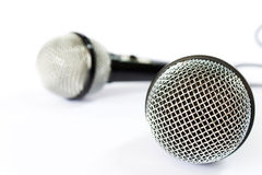 Microphone with black wire isolated on white Royalty Free Stock Photo