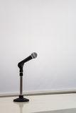 Microphone with a blank whiteboard Stock Images