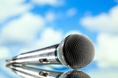 Microphone on blue Royalty Free Stock Images
