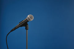 Microphone on blue Stock Photography