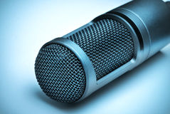 Microphone on blue background Royalty Free Stock Photography