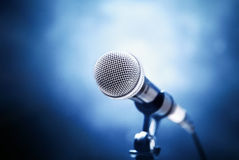 Microphone. On a blue background Royalty Free Stock Photo