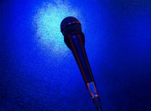 Microphone on  blue background. Microphone on blue background, light Royalty Free Stock Image