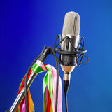 Microphone on blue background Stock Images