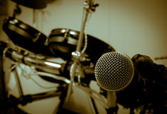 Microphone on blur drum background. Stock Images