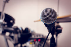 Microphone on blur drum background. Stock Photography