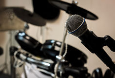 Microphone on blur drum background and vignetting. Stock Image