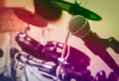 Microphone on blur drum background by vintage tone and vignettin Royalty Free Stock Photography