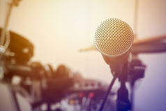 Microphone on blur drum and flare light background. Stock Photo