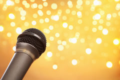 Microphone with blur light Stock Images