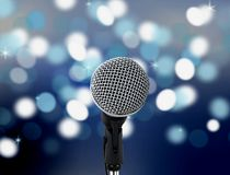 Microphone with blur lights in background. Image of microphone with blur lights in background Stock Photography