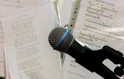 Microphone on the blur lyric background. Royalty Free Stock Image