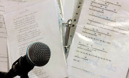 Microphone on the blur lyric background. Royalty Free Stock Images