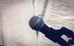 Microphone on the blur lyric background . Stock Photos