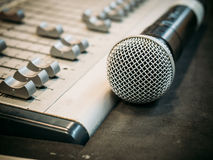Microphone on the blur sound mixer background. Stock Photo