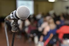 Microphone. With a blurred background audience stock photography