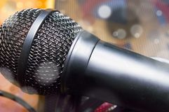 Microphone on a blurred background and particles close-up.  stock images