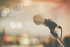 Microphone and bokeh background, concept as music instrument in studio room and meeting. Hall royalty free stock photos