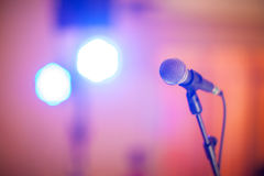 Microphone and bokeh background. Microphone in concert hall or conference room soft and blur style for background.Microphone over the Abstract blurred photo of Stock Image