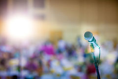 Microphone and bokeh background. Microphone in concert hall or conference room soft and blur style for background.Microphone over the Abstract blurred photo of Stock Photos