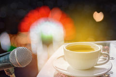 Microphone with bokeh lights of the stage concert light and soun. Abstract soft blurred and soft focus a cup of coffee, the microphone of the stage concert light Royalty Free Stock Image